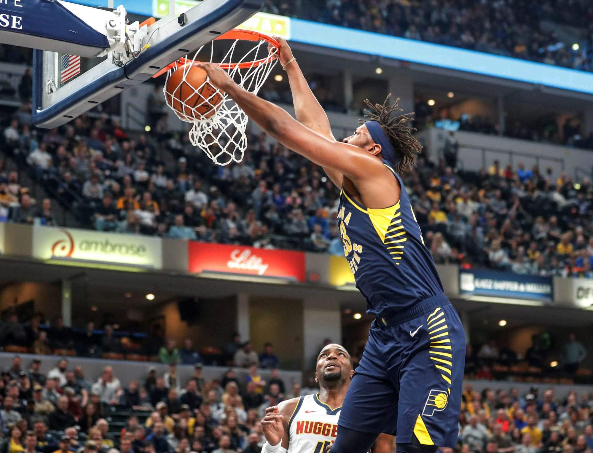 Indiana Pacers center Myles Turner dunks against the Denver Nuggets during  Sunday s game in Indianapolis. 7b4481edd