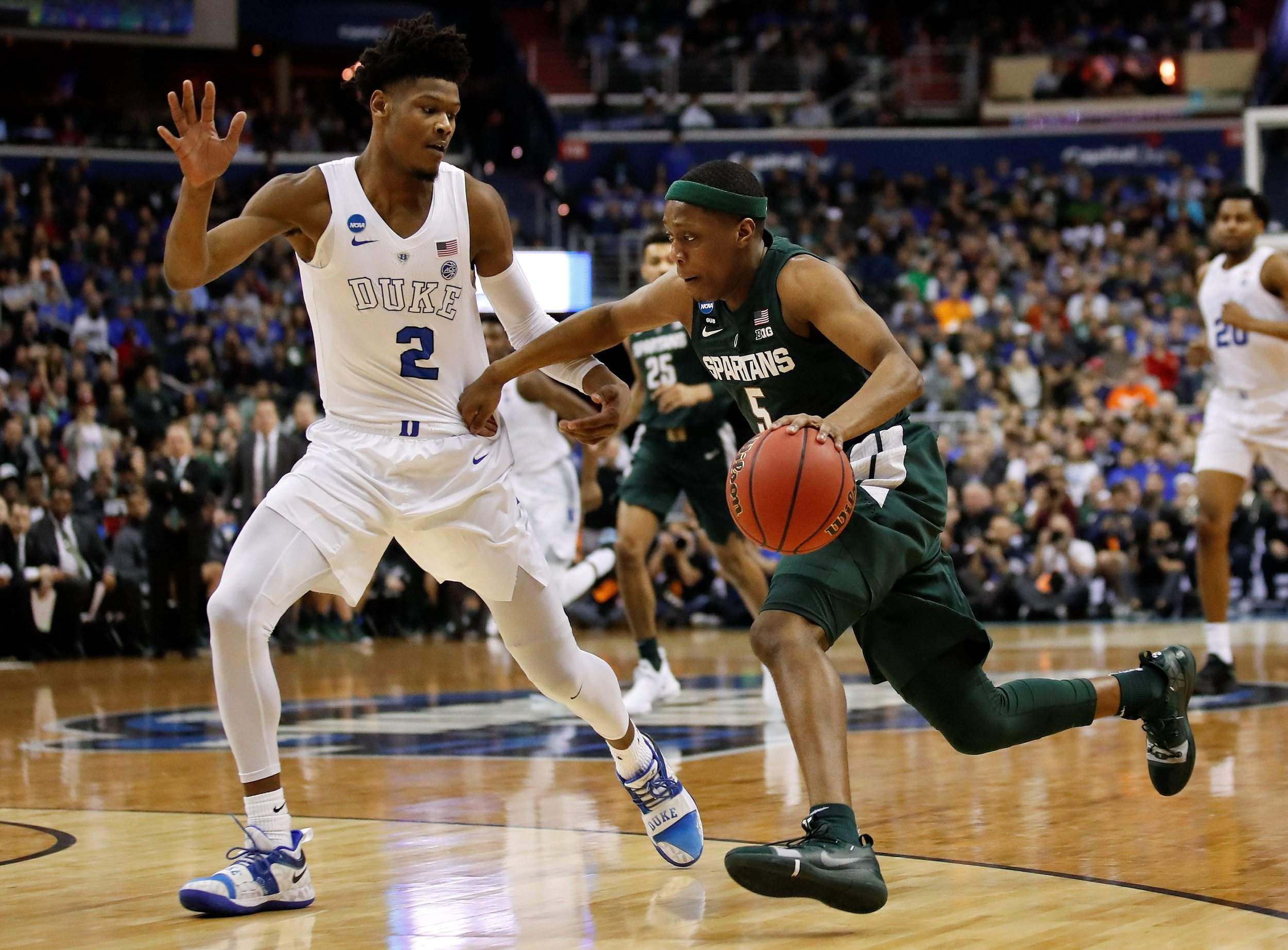 ef6fef2a8f47 Michigan State guard Cassius Winston drives past Duke forward Cam Reddish  during the first half of the East Regional final NCAA Tournament game in ...