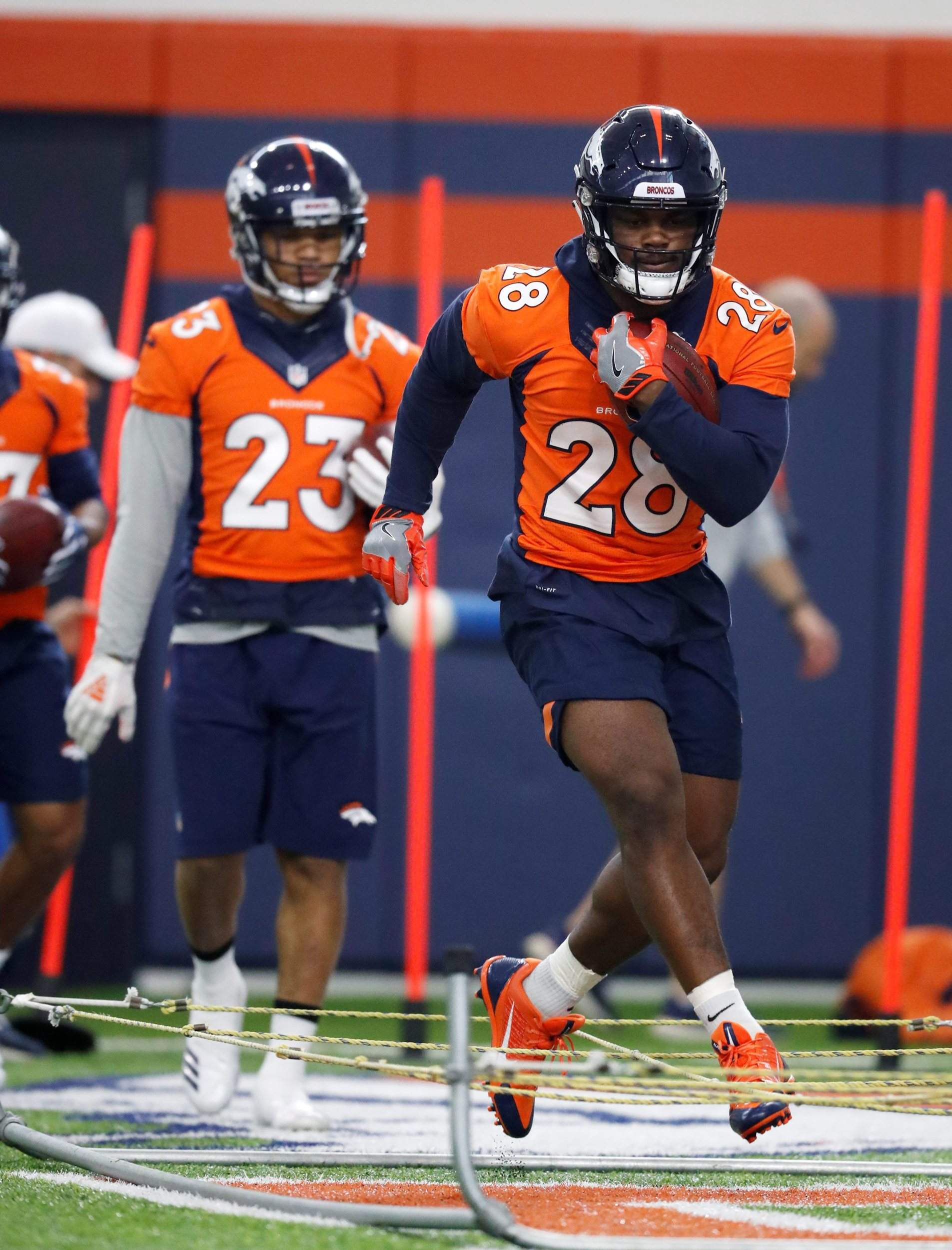 de38064a609 Denver Broncos running back Royce Freeman takes part in drills during the  team's veterans minicamp Tuesday in Englewood.