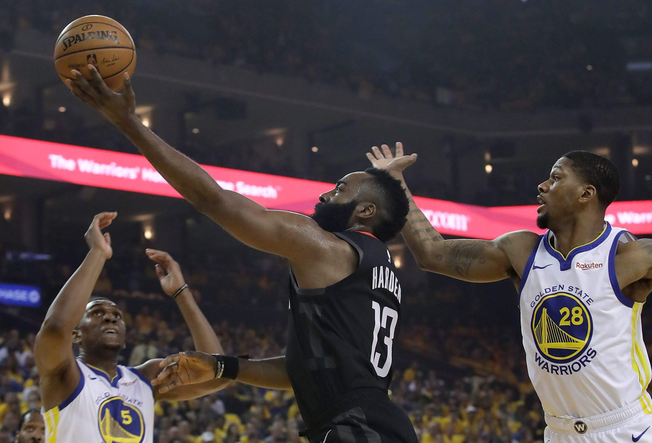 cf2d6c144671 ... guard James Harden (13) shoots between Golden State Warriors center  Kevon Looney (5) and forward Alfonzo McKinnie (28) during the first half of Game  1 ...
