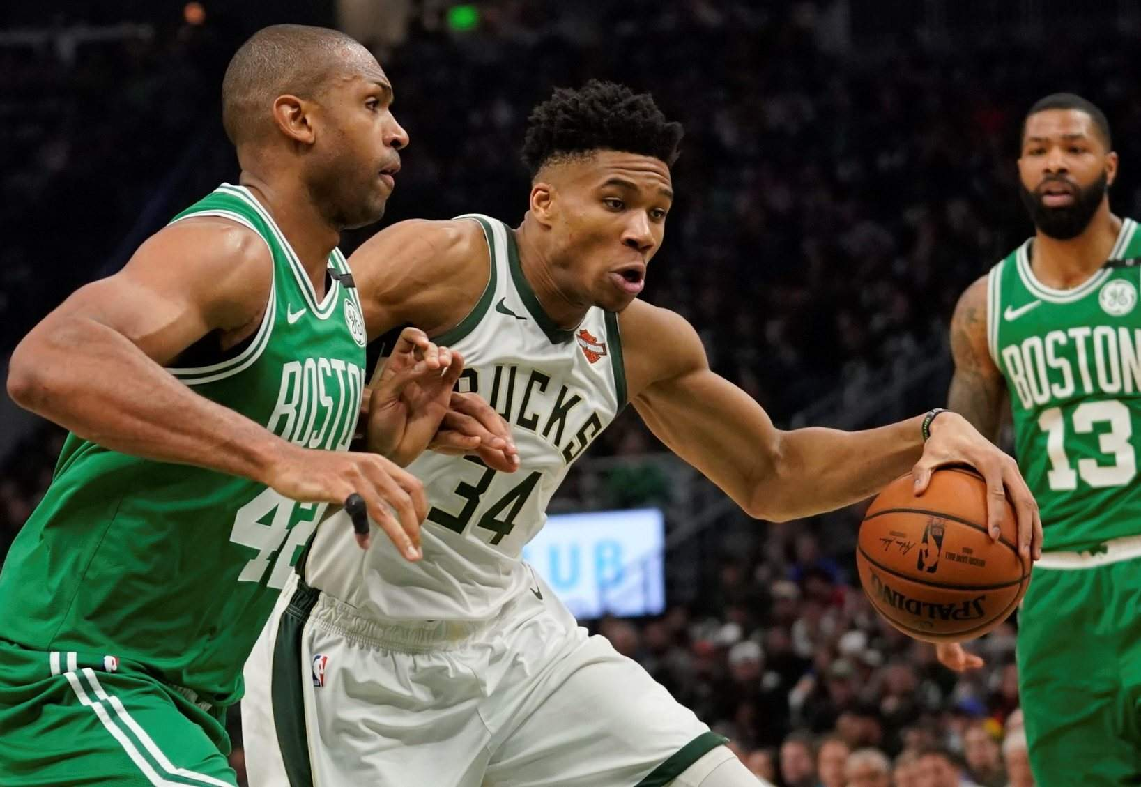 3ba9d499140a Milwaukee Bucks  Giannis Antetokounmpo tries to drive past Boston Celtics   Al Horford during the first half of Game 5 of a second round playoff series  ...