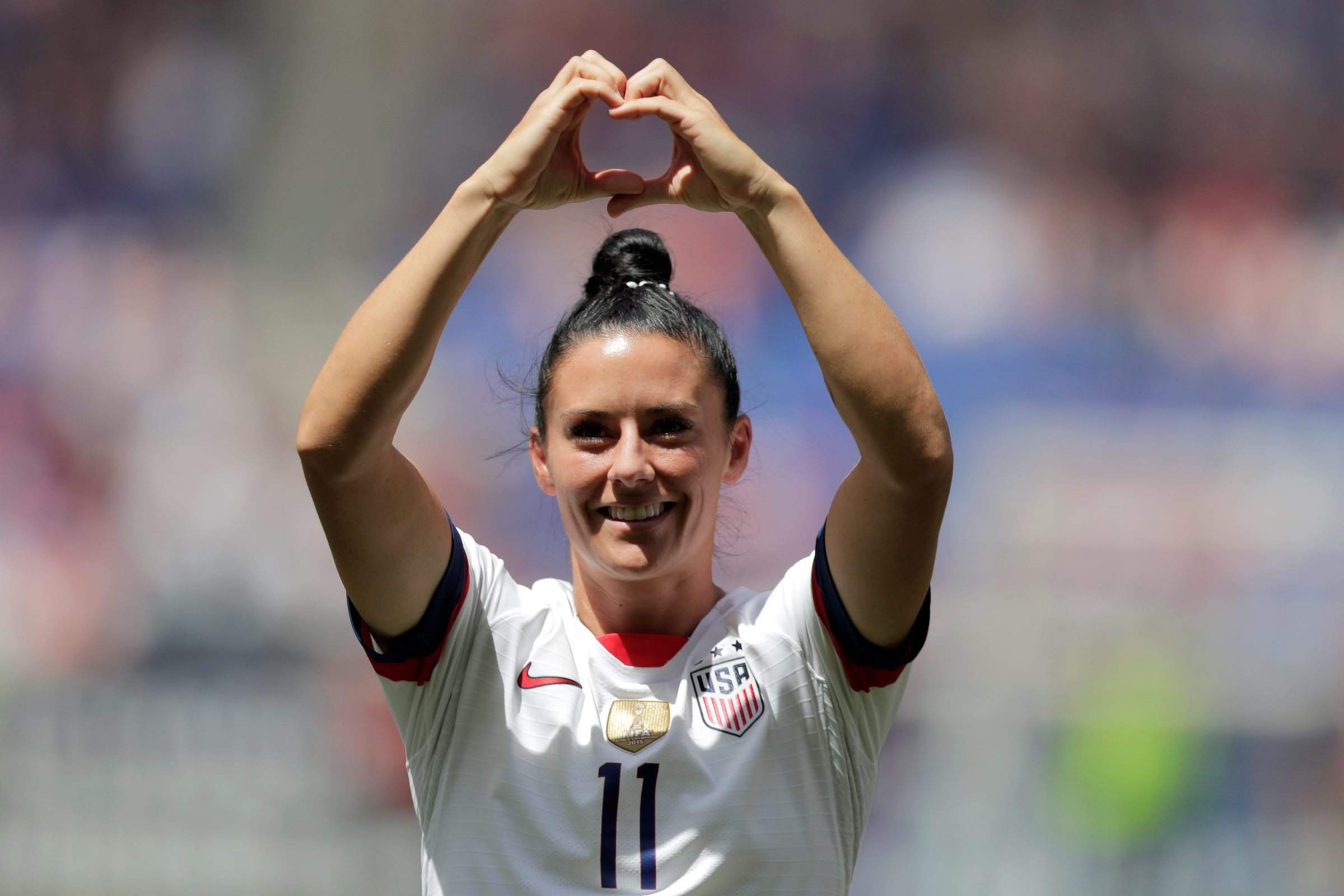 2cea4aedc09 Ali Krieger, a defender for the United States women's national team which  is headed to the FIFA Women's World Cup, is introduced to fans during a  send-off ...