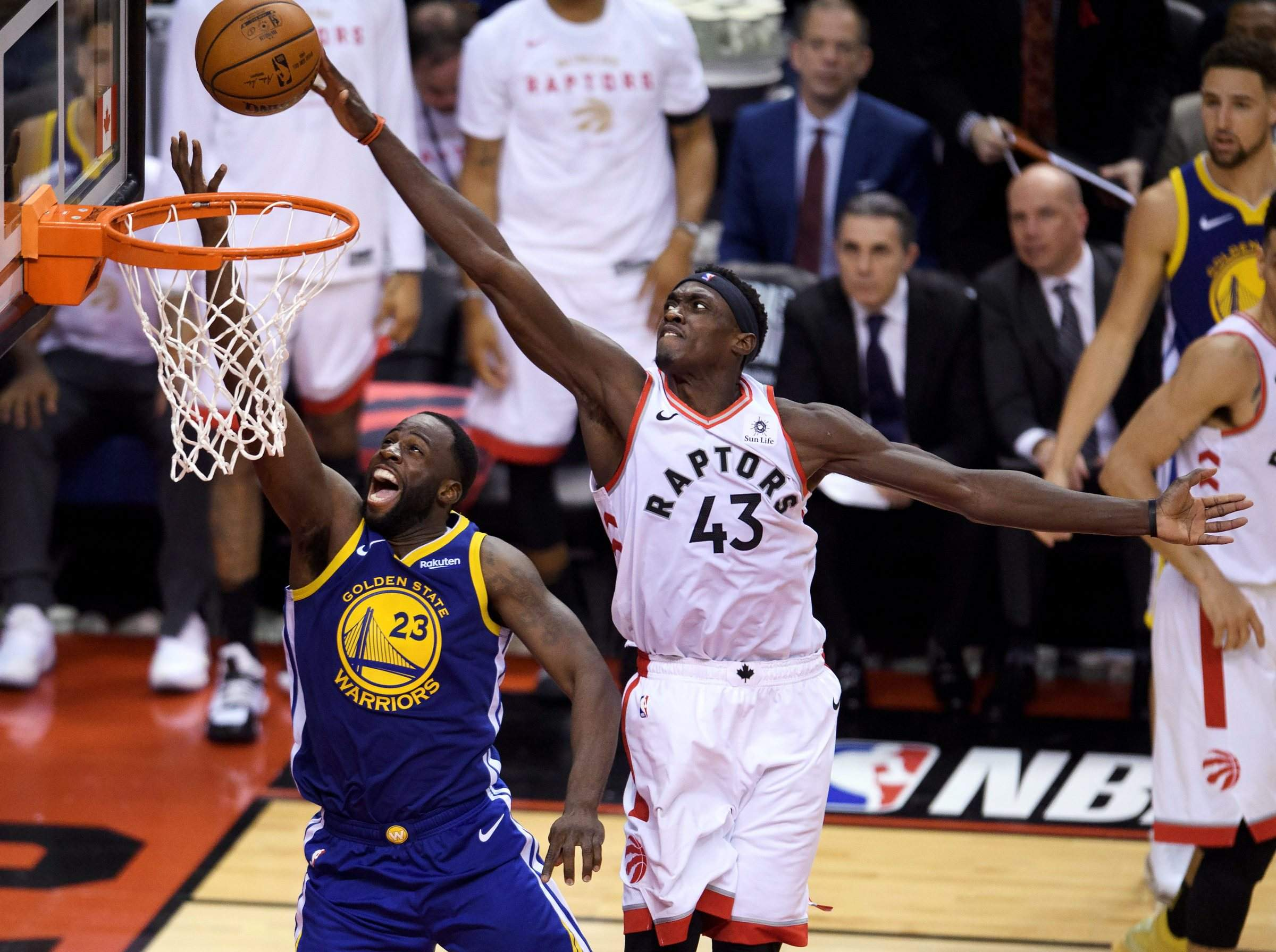 c1e29542d48 Toronto Raptors forward Pascal Siakam blocks a shot by Golden State Warriors  forward Draymond Green during the second half of Game 1 of the NBA Finals on  ...